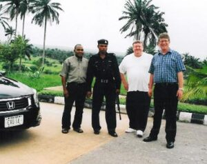 StormMeister™ founder Malcolm Snape (far right) with fellow British engineer Ron Smith (white T-shirt) in Nigeria whilst working as advisors to the Akwa Ibom State Government. Also pictured are State Government driver Manny and State Police protection officer GodsGift.