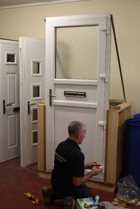 StormMeister™ Flood Door being installed in a showroom testing tank in Dublin, Republic of Ireland.