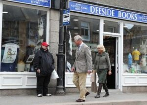 April 2017. The Prince of Wales and the Duchess of Cornwall, known as the Duke and Duchess of Rothesay while in Scotland, leave Deeside Books and gift shop which has reopened following flooding, in Ballater, Aberdeenshire. The shop is now protected from flooding by StormMeister™ Flood Doors which following flooding that occurred in December 2015 have been installed in approximately 30 commercial and residential properties in Ballater in the Cairngorms National Park close to the Royal summer residence at Balmoral.